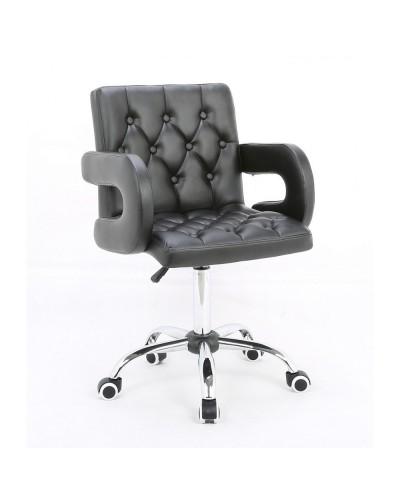 Ron – Fotel fryzjerski tapicerowany czarną eco-skórą z guzikami tapicerskimi